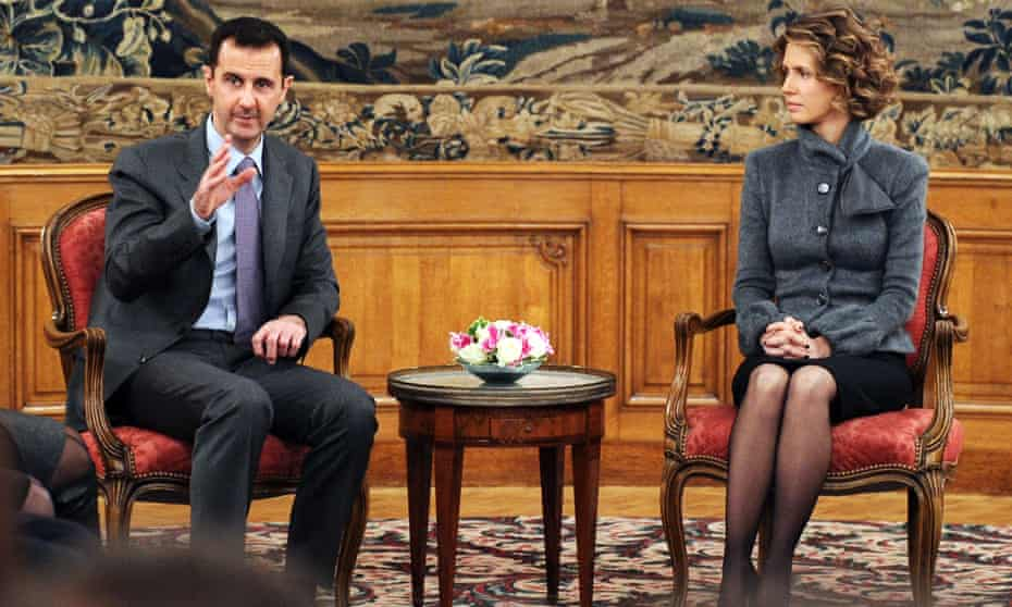 President Assad, with his wife Asma, delivers a speech in Paris in 2010.