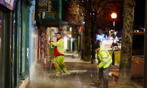 Clearing up after the floods in Cockermouth, Cumbria.