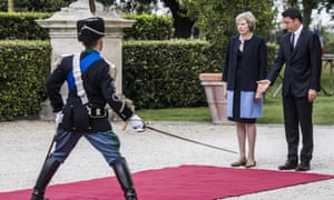 Theresa May receives a ceremonial welcome at she arrives in Italy to meet the prime minister Matteo Renzi (right)
