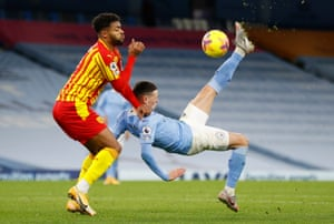 Manchester City's Phil Foden attempts an overhead kick under pressure from West Bromwich Albion's Darnell Furlong.