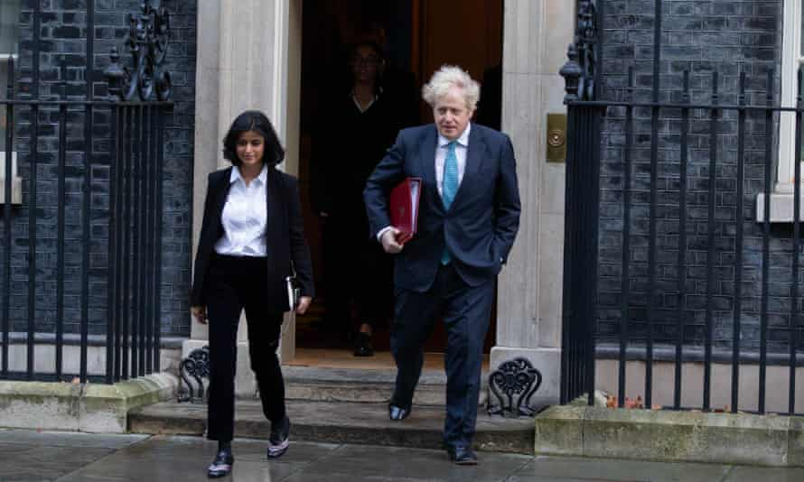 Boris Johnson with Munira Mirza, director of No 10's policy unit, in Downing Street.