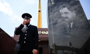 A police officer guards the memorial to Akhmad Kadyrov, the father of Ramzan Kadyrov, who was assassinated by Chechen Islamists in 2004.