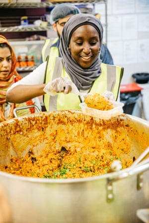 A volunteer serves the attendees of the Grand Bristol Iftar.