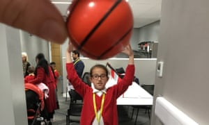Is this basketball enormous or miniature?