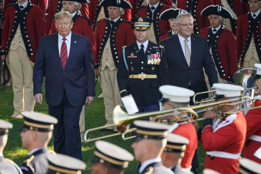 Trump and Morrison review the troops during an official arrival ceremony.