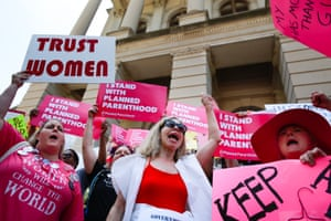 """People protest against Georgia's recently passed """"heartbeat"""" bill at the Georgia State Capitol building, on May 21, 2019 in Atlanta, Georgia. The bill would ban abortion when a fetal heartbeat is detected."""