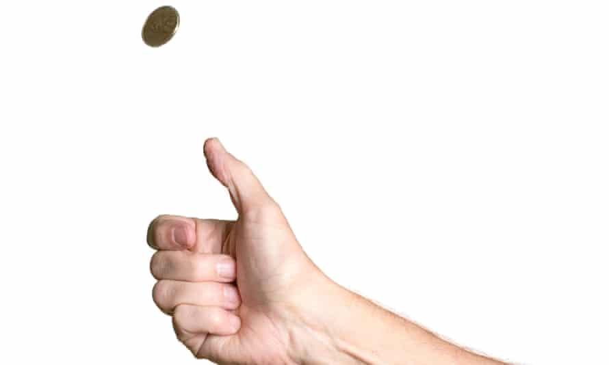 a man tosses a coin