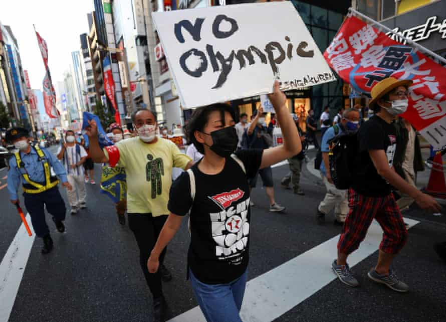 Anti-Olympic protesters march through Tokyo during Games