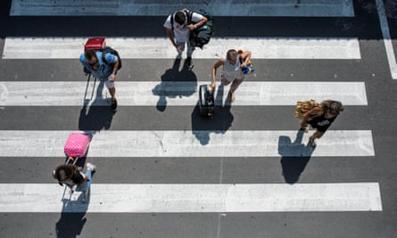 Tourists leave the airport on Menorca in the Balearic islands on 27 July.