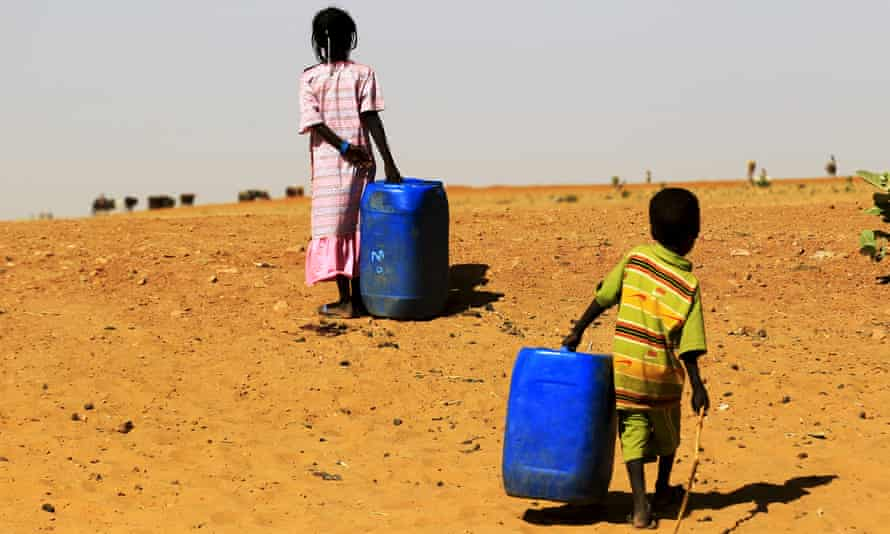 Children fleeing from clashes in Sudan's East Jebel Marra arrive at the Zam Zam displaced persons camp.