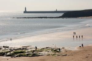Walkers on Tynemouth beach