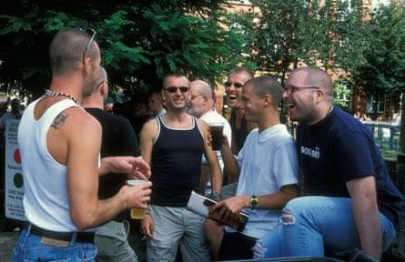 Men drinking at Gayfest in Canal Street, Manchester, 2001.