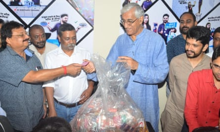 Chhattisgarh health minister, TS Singh Deo, right, brought half a kilo of plastic to the launch of the Garbage Cafe to emphasise that the scheme was for everyone.