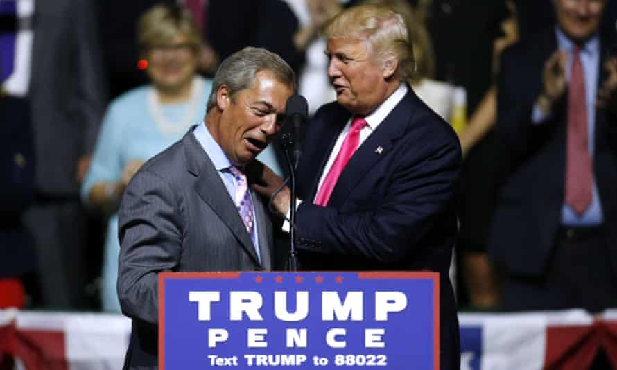 Donald Trump greets Nigel Farage during a campaign rally in Mississippi.