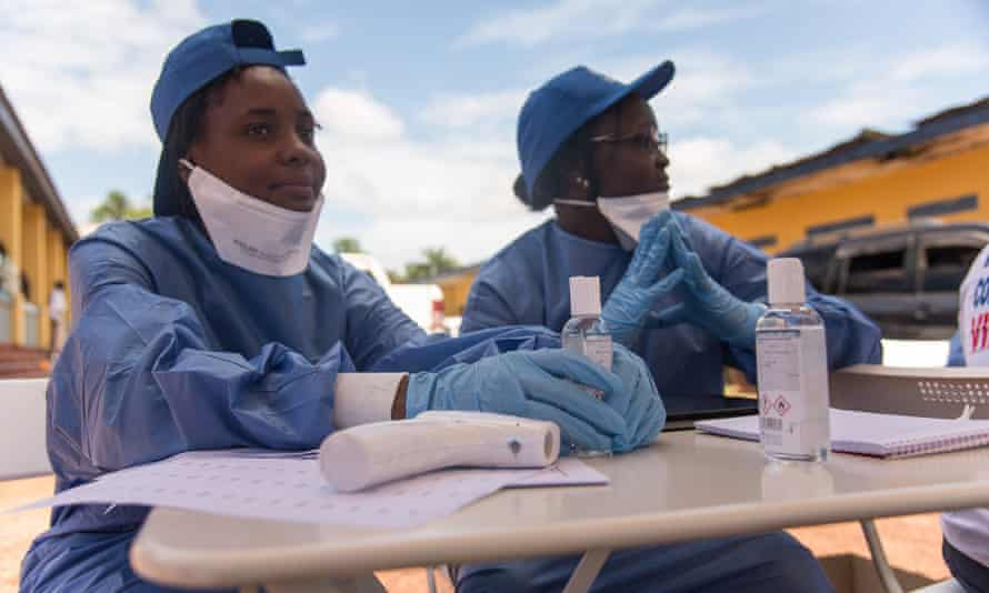 Nurses prepare to administer Ebola vaccine in Mbandaka in the Democratic Republic of Congo.