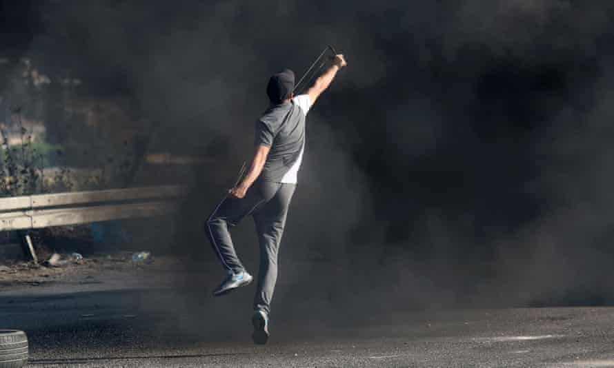 Palestinian protesters burn tyres and throw stones at Israeli forces in the West Bank town of Nablus.