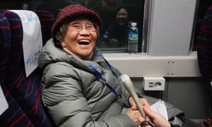 Kim Geum-ok, who was separated from her family during the Korean war, boards a train to the ceremony in the border town of Kaesong.