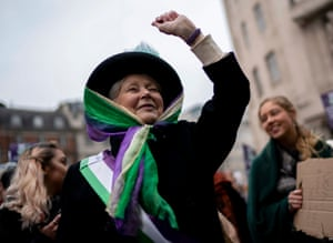 Woman in suffragette outfit