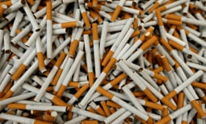 piles of loose Lucky strike cigarettes