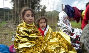 Newly-arrived children wait for humanitarian aid.