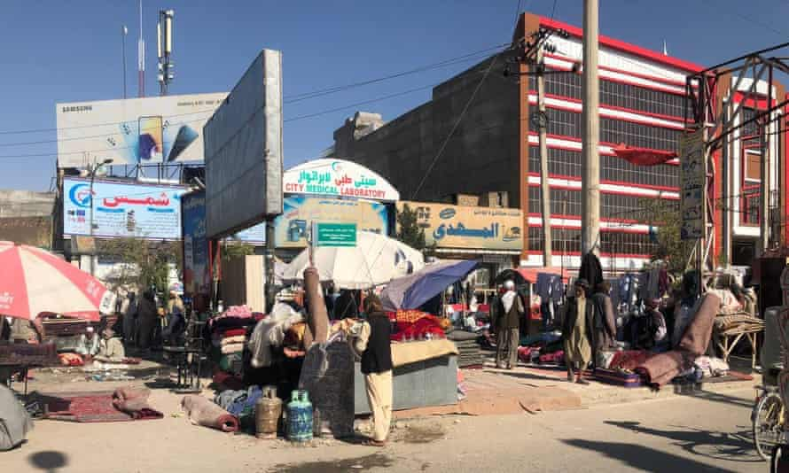 People sell their household goods at a market in Mazar-e-Sharif, Afghanistan, due to the economic insufficiency.