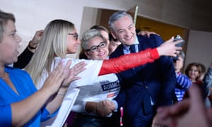 Robert Biedron, a co-leader of the leftwing alliance Lewica, poses for a selfie with supporters at a campaign event in Katowice