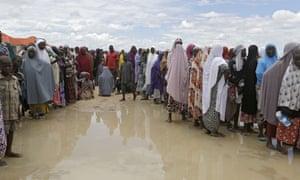 Women line up for food at Bakassi camp in Maiduguri