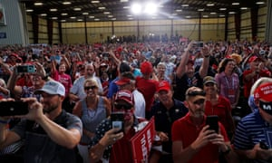 People attend a campaign rally by US President Donald Trump at Cecil Airport in Jacksonville, Florida, US, 24 September 2020.