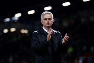 Jose Mourinho applauds fans after the match.