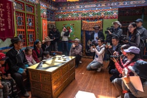 A Tibetan man who was relocated from a high-altitude area speaks to journalists at his house in Boma village. The picture was taken during a media tour to Tibet organized by the Chinese government that focused on China's poverty alleviation program for the region.