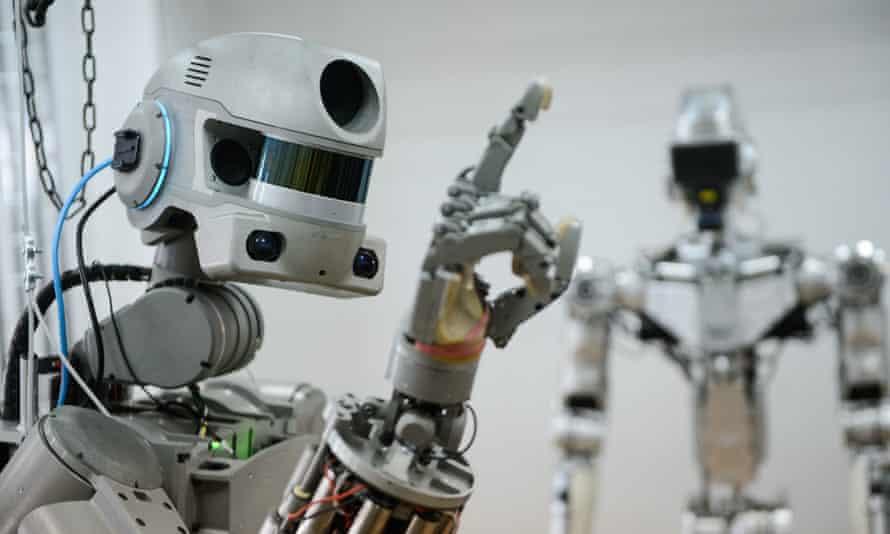 A robot prototype raises its hand