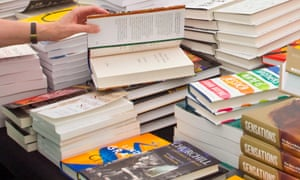 People browse copies of books