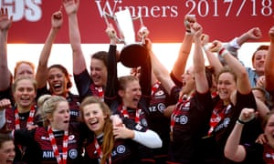 Lotte Clapp of Saracens lifts the trophy with her team-mates after victory in the Tyrrells Premier 15s Final against Harlequins.