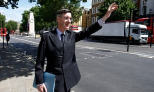 Jacob Rees-Mogg, hails a taxi in Whitehall, in central London, Britain July 16, 2018