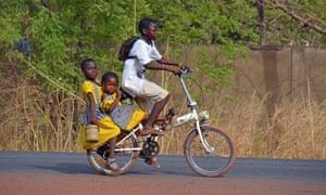 Two girls in Ghana get a bike ride to school