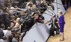 Theresa May talks to media before the European council meeting in Brussels.