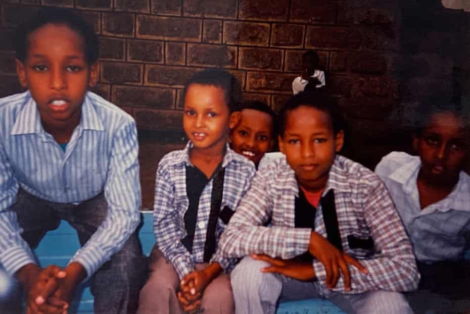 Hashi Mohamed, far left, in 1992, aged nine, with his brother and cousins in Nairobi.