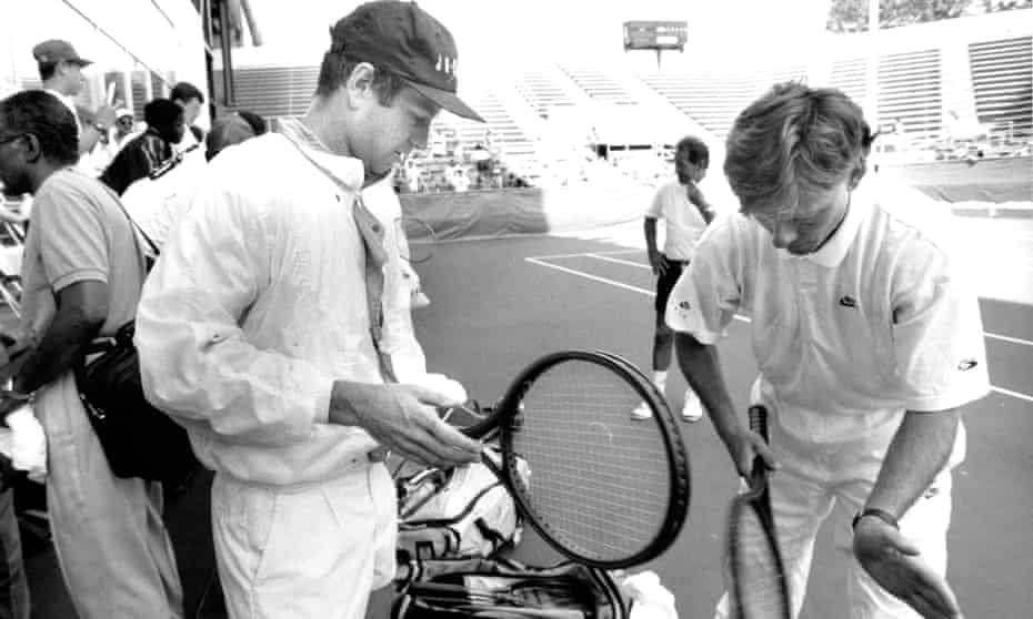 John McEnroe prepares to play Andre Agassi in the Arthur Ashe Aids Tennis Challenge, in 1992.