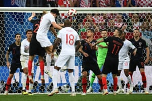 England's Harry Maguire gets up well but can't direct his header on target.