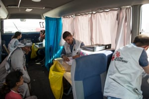 Inside an MSF mobile healthcare facility bus.