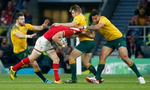 The Australian defence gets to grips with Wales' Liam Williams.
