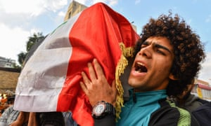 An Iraqi mourner chants slogans during a funerary procession in the central holy Shiite shrine city of Najaf on Thursday.