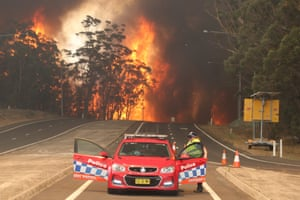 Flames cross the princes highway at the Sussex inlet intersection south of Nowra.