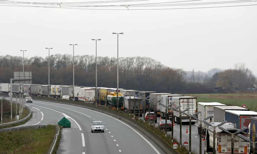 Lorries queue along the A16 motorway to board ferries and Eurotunnel in northern France