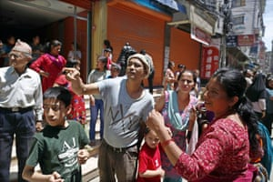 People stand in the street in Kathmandu after the 7.3-magnitude earthquake