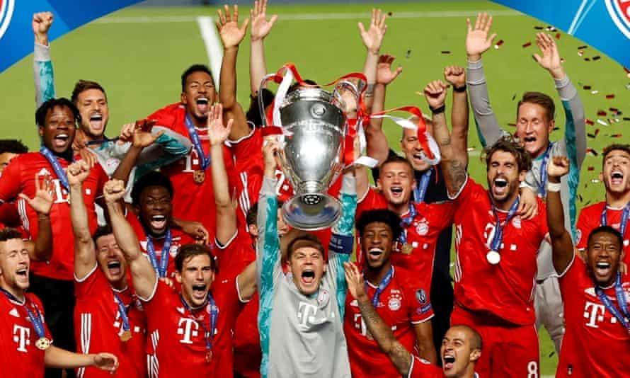 Bayern Munich lift the 2020 Champions League trophy.