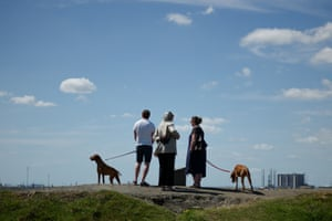Redcar, North Yorkshire A family walk their dogs at South Gare