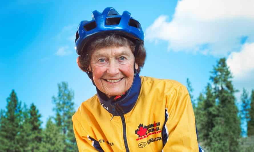 Sister Madonna Buder in a cycling helmet and yellow cycling top