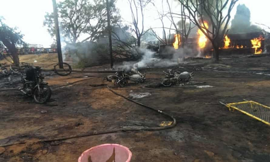 A building burns after a fuel tanker crashed in Morogoro