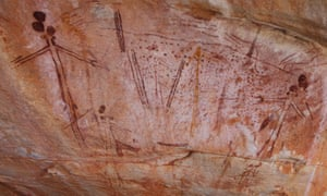 Wanjina rock shelter, showing figures with spears and fishing nets.